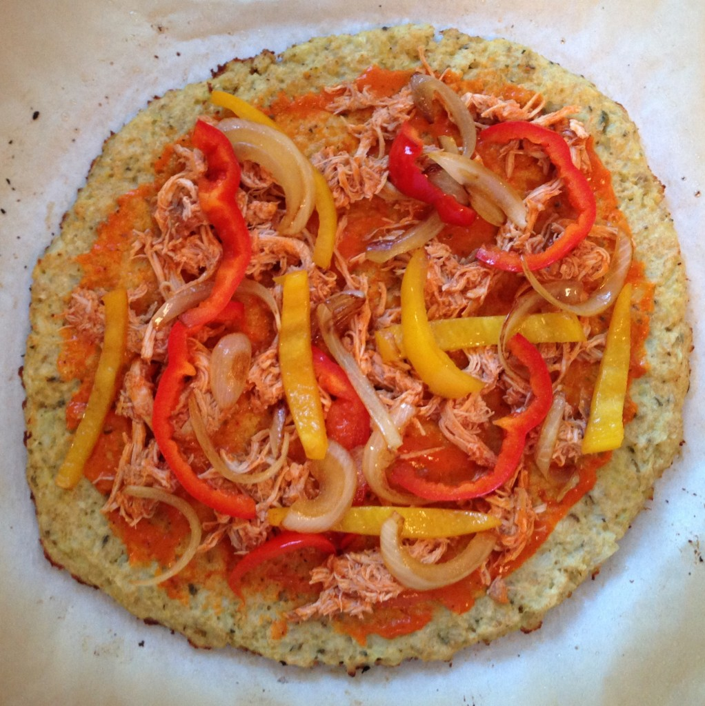 Cauliflower Pizza Crust - guesswhoscooking.com. dairy free, gluten free (option), low carb